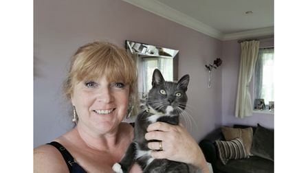 Cat charity founder with cat
