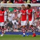Arsenal's Granit Xhaka (centre) is congratulated after scoring a goal during The Mind Series match a