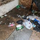 Broken bottles and litter outside the offices of One Place East