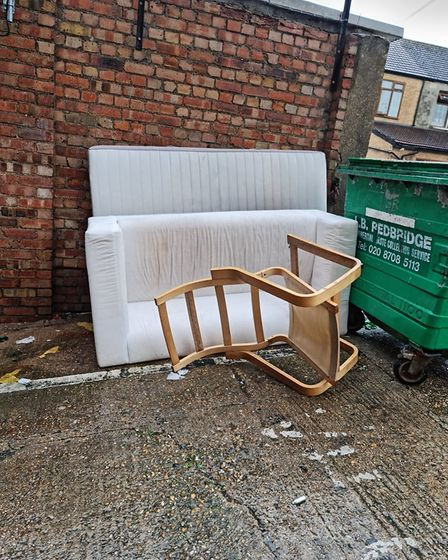 A fly-tipped mattress, sofa, and chair behind the offices of One Place East