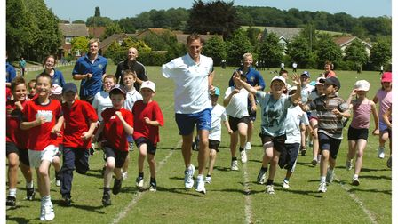 Danny Crates, 800 metres gold medallist at the Athens Paralympics, with children at Great Cornard Upper School in 2006