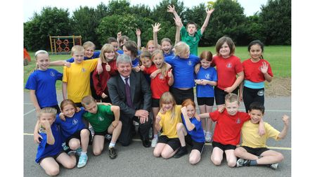 Sir Keith Mills, deputy director of the 2012 Olympics, with pupils atHeath Primary School in Kesgravein 2008