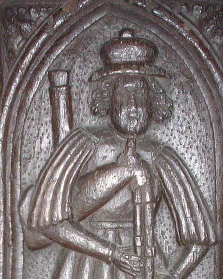 A wooden carving of a figure known as The Altarnon Piper