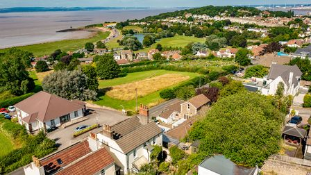 aerial view of properties in Nore Road, Portishead, with greenery and the Bristol Channel beyond