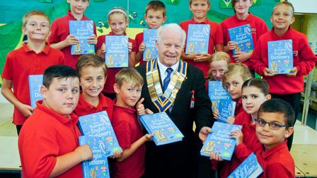 Weston Rotary Club president Terry Gilbert handing out Dictionariers for Life to pupils of Oldmixo