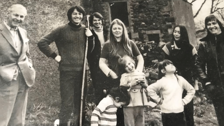 A black and white image from around 1974 of Piers Plowright in Cumbria with family and friends