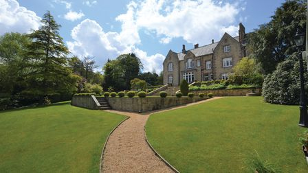 The house stands in lovely expansive grounds