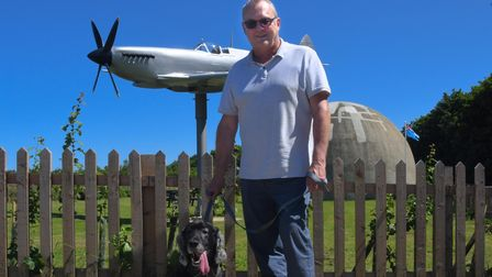 David King, who leads theNorth Norfolk U3A's Military History Group, with his dog Dexter at the Langham Dome.