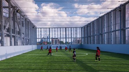Hackney and Tower Hamlets' Impact FC playing on Britannia's rooftop pitches.