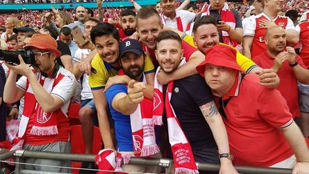 Danny Bailey (right) with fellow Arsenal supporters