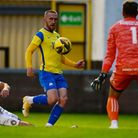 Connor Lemonheigh-Evans of Torquay United tries to chip Lewis Williams, Goalkeeper of Tiverton Town