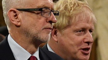 Prime Minister Boris Johnson (right) speaks with Jeremy Corbyn in the Central Lobby before the elect