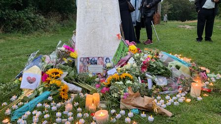 Flowers, candles and cards left at a memorial in Fryent Country Park to remember Bibaa Henry and Nicole Smallman