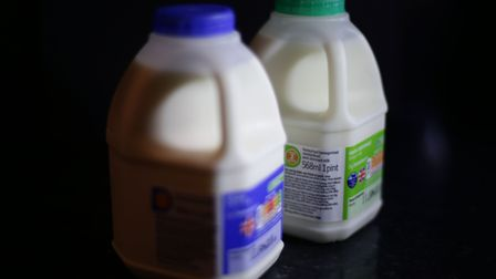 A pint of whole milk (left) and a pint of semi-skimmed milk, in London. PRESS ASSOCIATION Photo. Pic