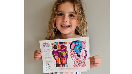 Annabel Baldwin,6, holding her entry to the Big Hoot Colouring Competition