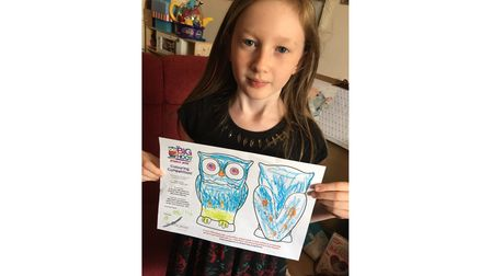 Delilah Reynolds, 8, with her drawing