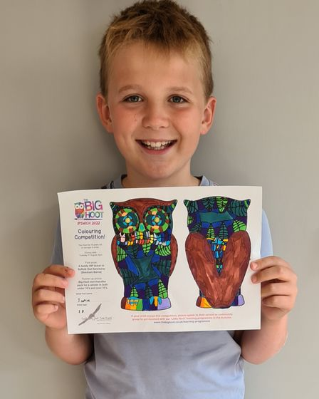 Jamie Baldwin,10, with his entry to the Big Hoot Colouring Competition
