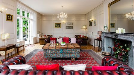 The grand sitting room is an elegant place to relax and enjoy views of the grounds