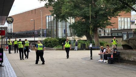 Police searching the vicinity of the Alban Arena following a fight.