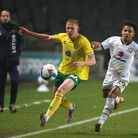 Matthew Sorinola of Milton Keynes Dons and Ethen Vaughan of Norwich City in action during the Papa J