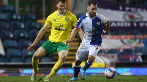 Christoph Zimmermann of Norwich and Adam Armstrong of Blackburn Rovers in action during the Sky Bet