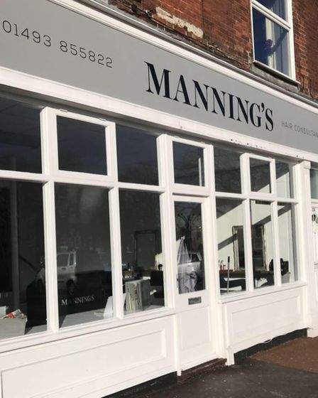 Exterior of Manning's Hair Consultants.