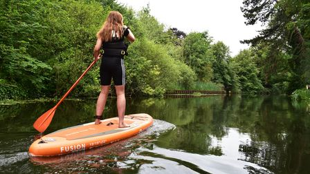 EDP reporter Emily Thomson paddleboarding on the River Wensum with Norwich Paddleboard Hire.