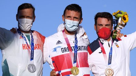Huntingdon's Giles Scott with his gold medal fromthe men's finn class at the Tokyo 2020 Olympic Games