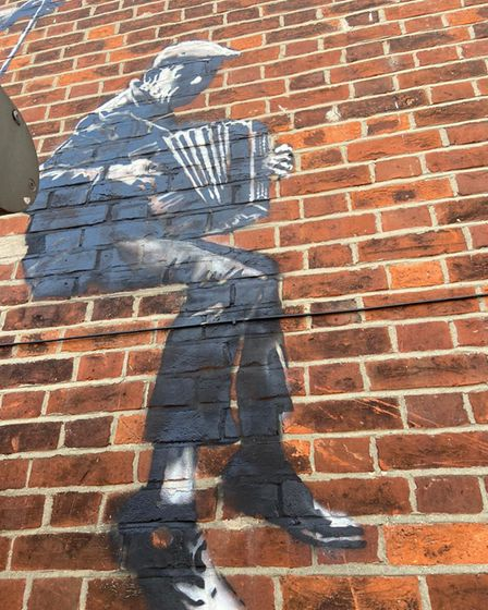 Close up of accordionist in the street art work.