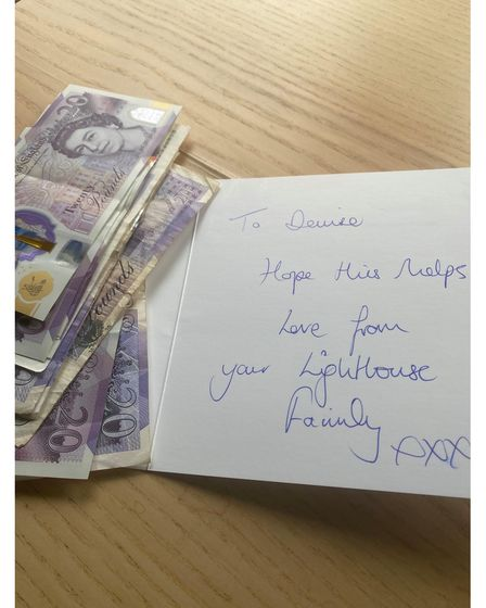 The money and a card from Songworks choir covering the fine