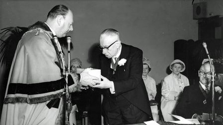 TheMayor of Torquay presents civic dignitaries with onyx caskets.