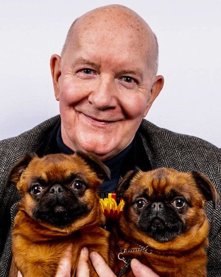 George Hodson pictured with his prized Belgian Griffons