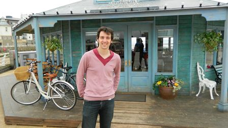 Actor Ralf Little in front of the turquoise summerhouse-style cafe on set of the Sky One sitcom The Café