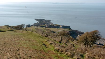 Views from atop Brean Down after climbing it. Green headland with sea surrounding it