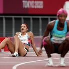 Jodie Williams sits on the track behind winner Shaunae Miller-Oibo after finishing sixth