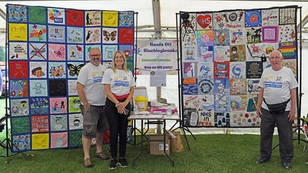 The Hands Off Hinchingbrooke group with the community quilt at Huntingdon Carnival.