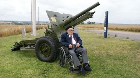 The late Albert Figg, shown here in 2018 with the then newly-purchased 25-pounder field gun on The Hill 112 memorial site