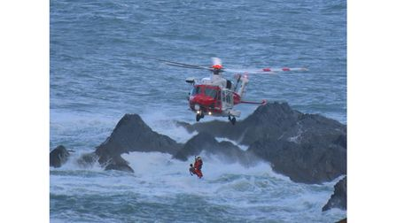 Helicopter winches man to safety
