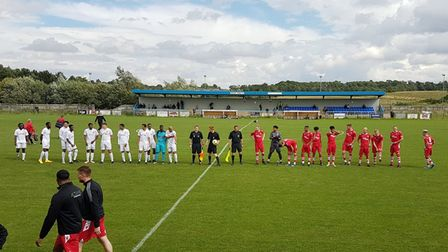 Baldock Town and Wembley line-up prior to the FA Cup extra-preliminary round tie at New Lamb Meadow