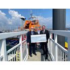 Group presents giant cheque to lifeboat