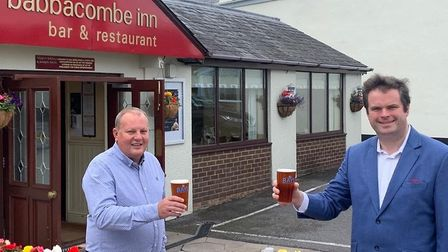 Torbay MP Kevin Foster (right) raises a glass to re-opening with Babbacombe Inn boss Martyn Strange