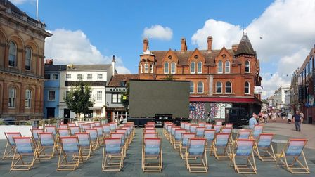 Deckchairs in front of big screen on the Cornhill