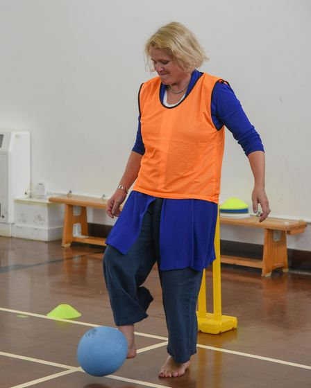 Children's Minister Vicky Ford having a go at kick rounders at St William's Primary School's summer