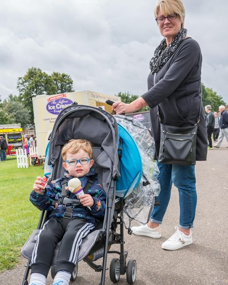 A little boy wearing thick blue glasses holding an ice cream at the Saffron Walden Motor Show 2021