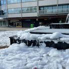 Foam littered Stevenage's town square on Sunday after pranksters filled the fountain with washing up liquid