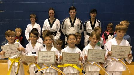 Some of the taekwondo students who passed the colour belt grading