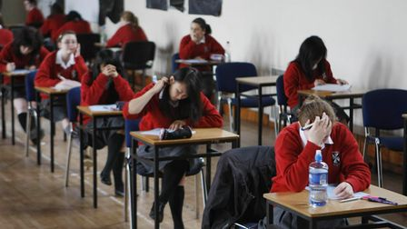 Undated file photo of students sitting an exam. Tens of thousands of students in England will receiv