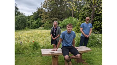 Carpenters and worker with oak bench donation for hospice