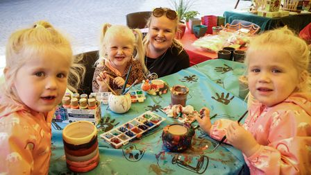 Twins Ruby and Myla aged three, their cousin Lily aged three and her mum Jade, at Gardening for Kids pop-up, Saffron Walden