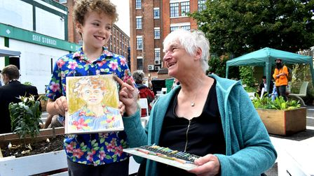 Artist Andrea Tierney offered portrait drawing. Pictured with subject Sonny Charles-Boyle, 9,and the finished sketch